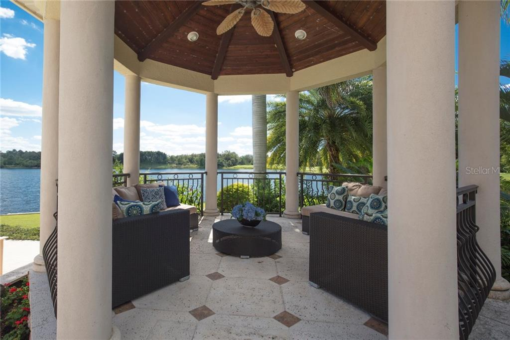 Lakeside and poolside pavilion - so many options this beautiful space could be used for!!! - Single Family Home for sale at 7320 Barclay Ct, University Park, FL 34201 - MLS Number is A4200908