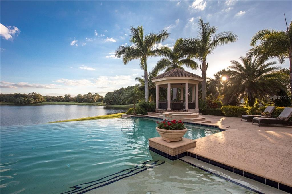 Doesn't get better than this!  Sun setting behind mature palms while enjoying this luxurious terrace and vast view. - Single Family Home for sale at 7320 Barclay Ct, University Park, FL 34201 - MLS Number is A4200908
