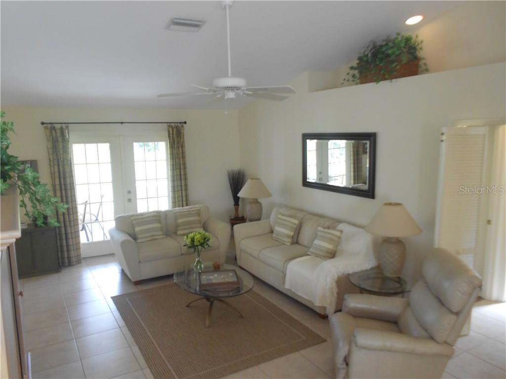Great Room with French Doors leading to the Covered Screened Lanai - Single Family Home for sale at 6320 Hera St, Englewood, FL 34224 - MLS Number is A4200968