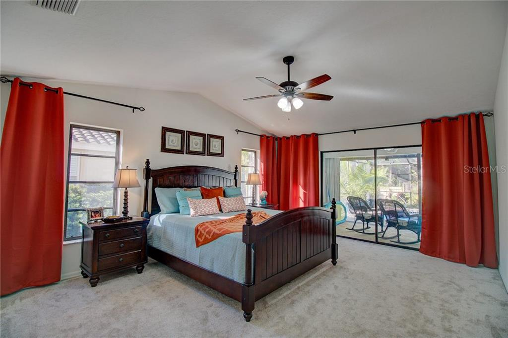 Master Bedroom Looking onto Pool and Patio - Single Family Home for sale at 1087 Hoover Cir, Nokomis, FL 34275 - MLS Number is A4201722