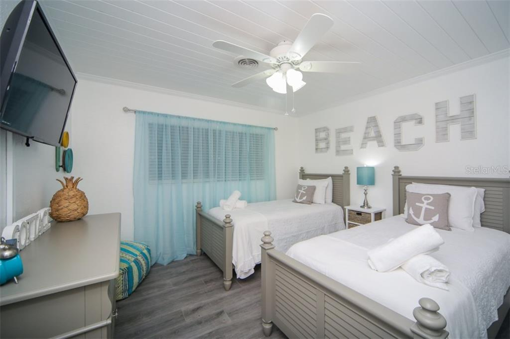 Second bedroom with french doors leading to pool - Single Family Home for sale at 213 70th St, Holmes Beach, FL 34217 - MLS Number is A4202171