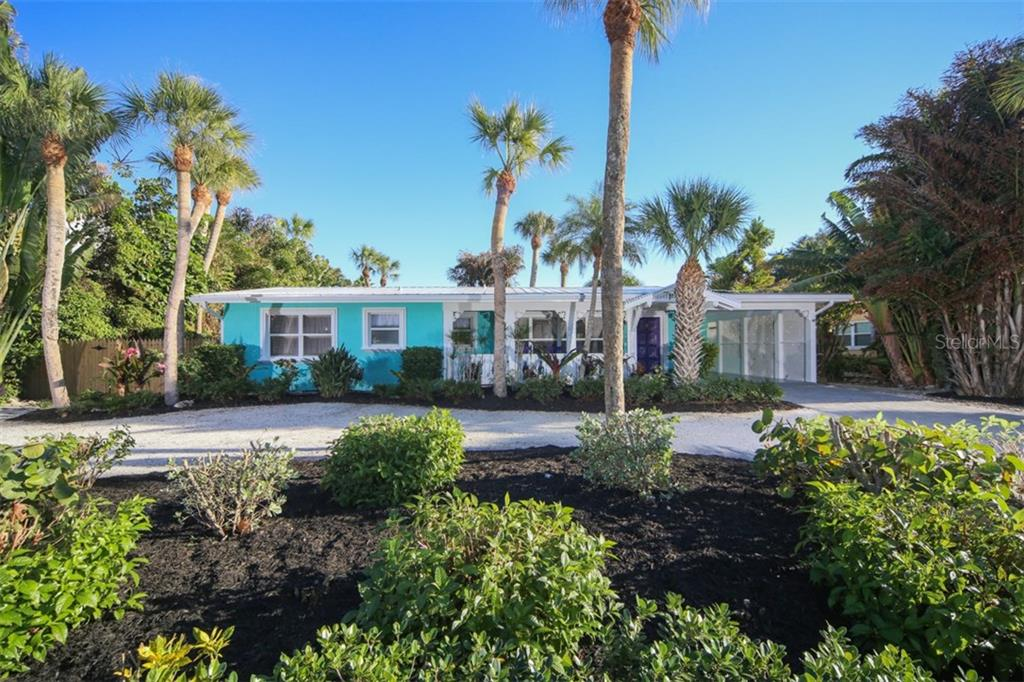 Paved driveway. New roof with 25 year warranty. - Single Family Home for sale at 213 70th St, Holmes Beach, FL 34217 - MLS Number is A4202171