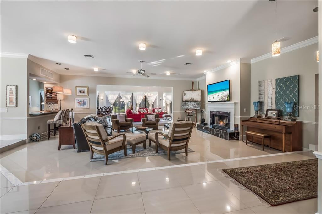 Open Concept Living in Your Great Room and Family Room - Single Family Home for sale at 5026 Kestral Park Way S, Sarasota, FL 34231 - MLS Number is A4203689
