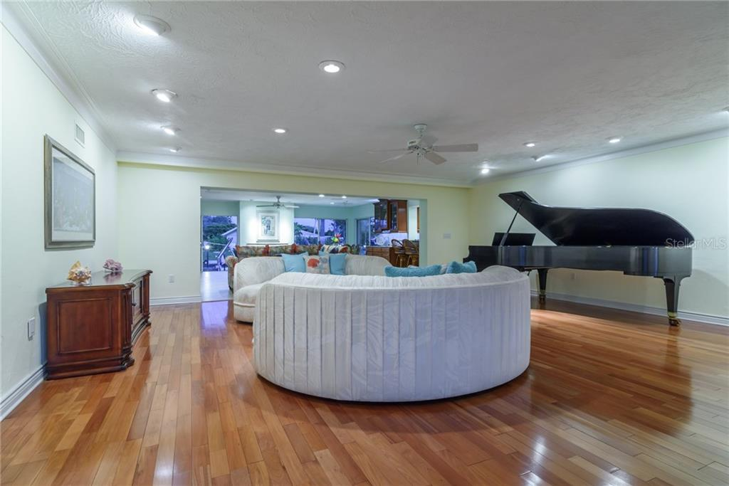 Living room at dusk - Single Family Home for sale at 5439 Azure Way, Sarasota, FL 34242 - MLS Number is A4203969