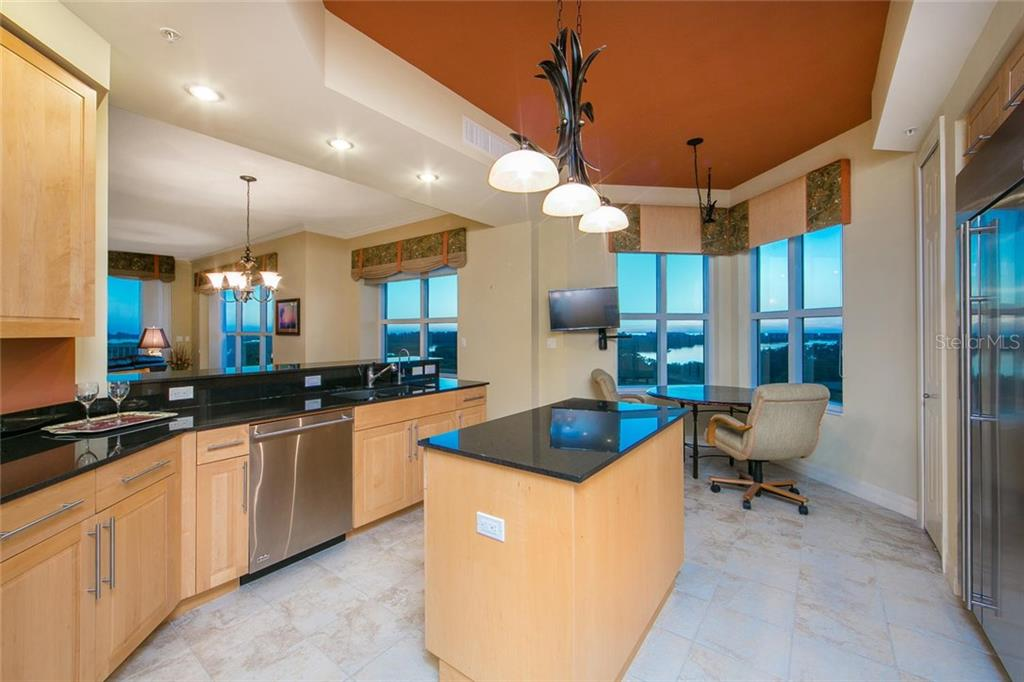 Incredible panoramic views of the intracoastal, mangrove preserves and Gulf of Mexico from the Kitchen and Breakfast Nook. - Condo for sale at 3603 N Point Rd #703bd6, Osprey, FL 34229 - MLS Number is A4204172
