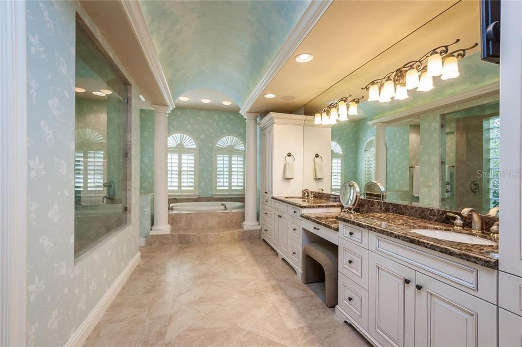 Gorgeous master suite restroom with separate walk-in shower and soaking tub, dual sinks and LOTS of cabinetry! - Single Family Home for sale at 8346 Farington Ct, Bradenton, FL 34202 - MLS Number is A4206244