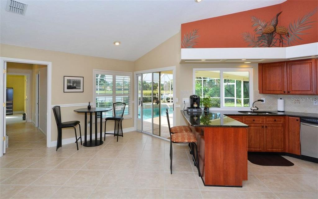 Eating area in kitchen - Single Family Home for sale at 3882 Spyglass Hill Rd, Sarasota, FL 34238 - MLS Number is A4206477