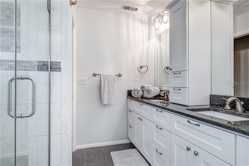 Beautifully updated master bath with dual sinks. - Single Family Home for sale at 5633 Cape Leyte Dr, Sarasota, FL 34242 - MLS Number is A4207008