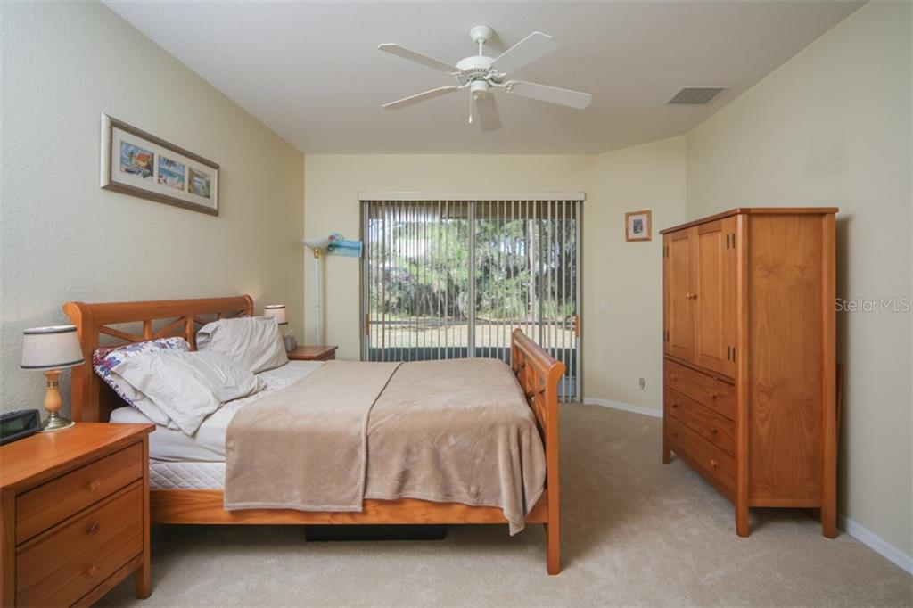 Master bedroom - Single Family Home for sale at 1876 Bushnell Ave, North Port, FL 34286 - MLS Number is A4207073