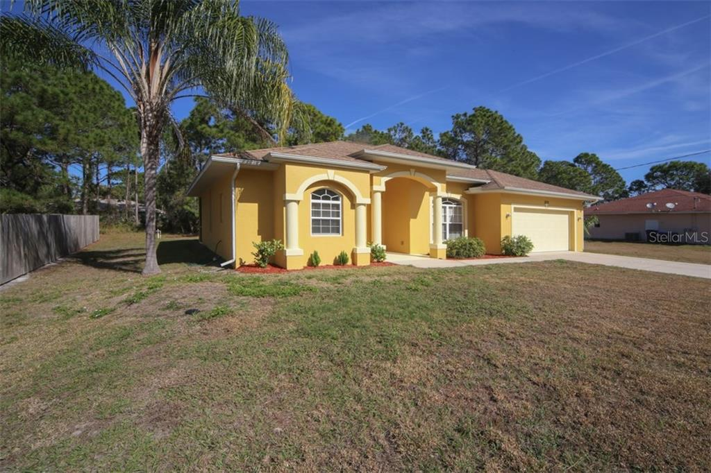 Front view - Single Family Home for sale at 1876 Bushnell Ave, North Port, FL 34286 - MLS Number is A4207073