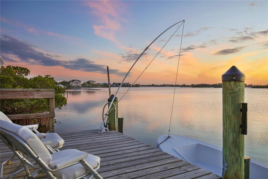 Take in gorgeous sunsets from the dock - Single Family Home for sale at 3930 Red Rock Way, Sarasota, FL 34231 - MLS Number is A4207508