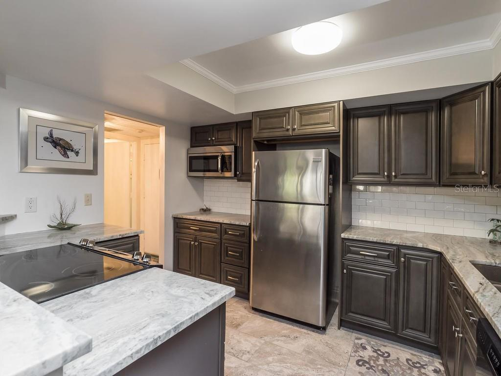 Condo Rider - Condo for sale at 800 Benjamin Franklin Dr #104, Sarasota, FL 34236 - MLS Number is A4208704