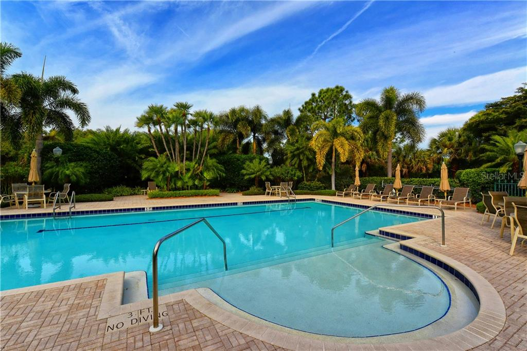 Heated pool at community center. - Condo for sale at 5242 Parisienne Pl #201bd30, Sarasota, FL 34238 - MLS Number is A4208770