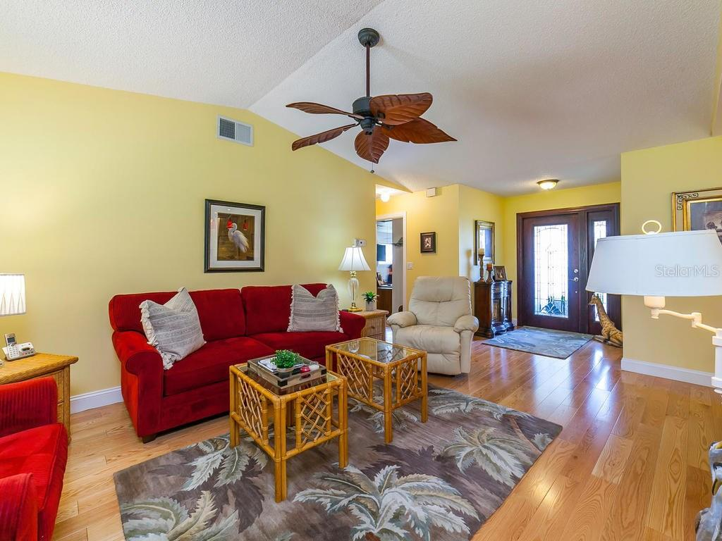 Living Room - Single Family Home for sale at 411 Lyons Bay Rd, Nokomis, FL 34275 - MLS Number is A4209146