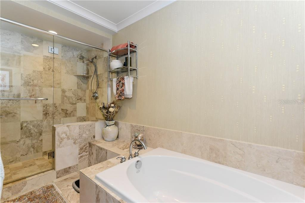 Master Bathroom with Tub and Shower. - Condo for sale at 1350 Main St #1106, Sarasota, FL 34236 - MLS Number is A4209424