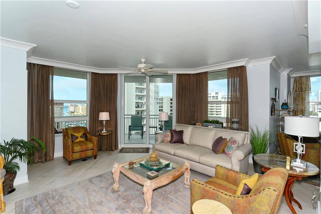 Living room with water and downtown views. - Condo for sale at 1350 Main St #1106, Sarasota, FL 34236 - MLS Number is A4209424