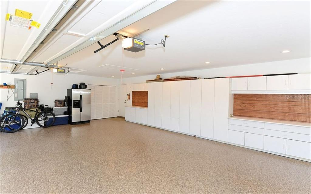 Oversized garage with epoxied flooring, extra storage, and hurricane rated garage door. - Single Family Home for sale at 5122 Willow Leaf Dr, Sarasota, FL 34241 - MLS Number is A4209555