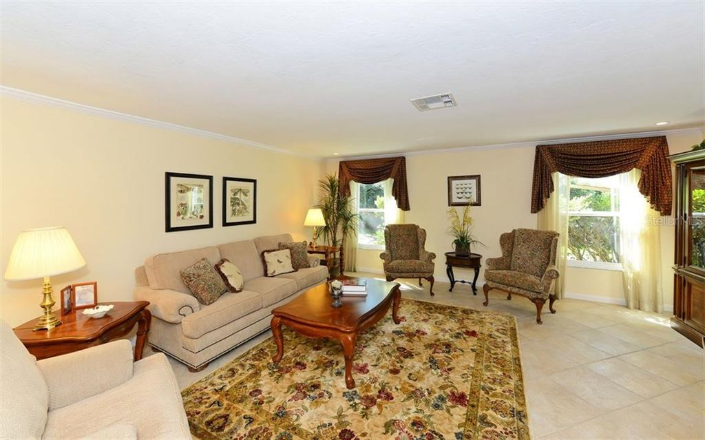 Formal living room is perfect for entertaining. - Single Family Home for sale at 5122 Willow Leaf Dr, Sarasota, FL 34241 - MLS Number is A4209555