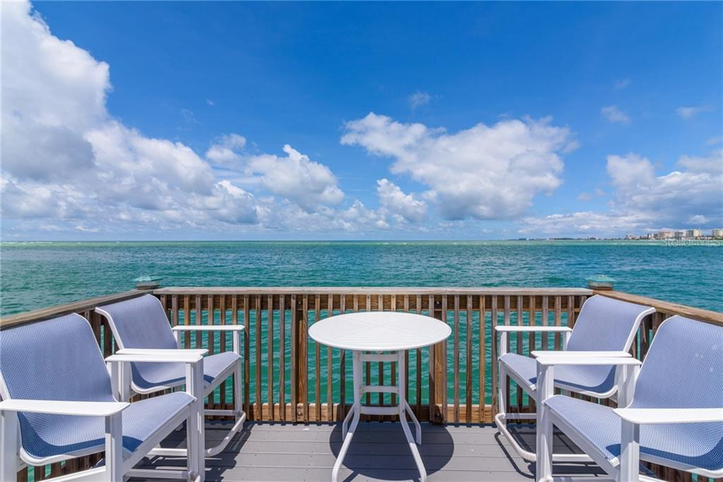 Watch the sunsets from the community pier - Condo for sale at 4822 Ocean Blvd #11d, Sarasota, FL 34242 - MLS Number is A4209955