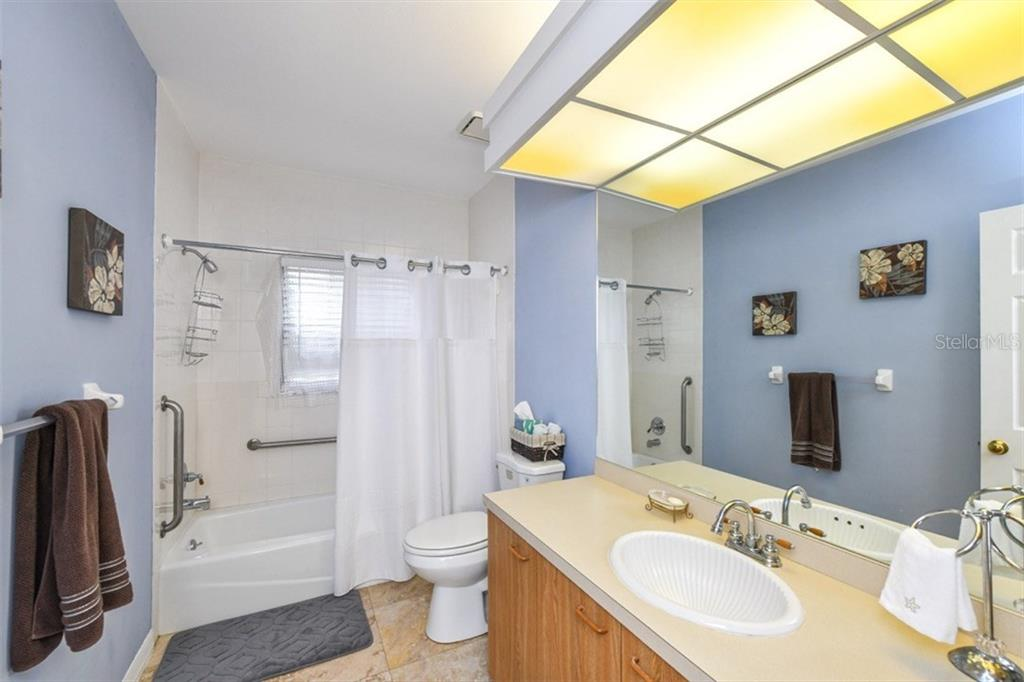 2 nd Bath with shower tub. Note grab bars in tub area. - Single Family Home for sale at 7536 Weeping Willow Dr, Sarasota, FL 34241 - MLS Number is A4210209