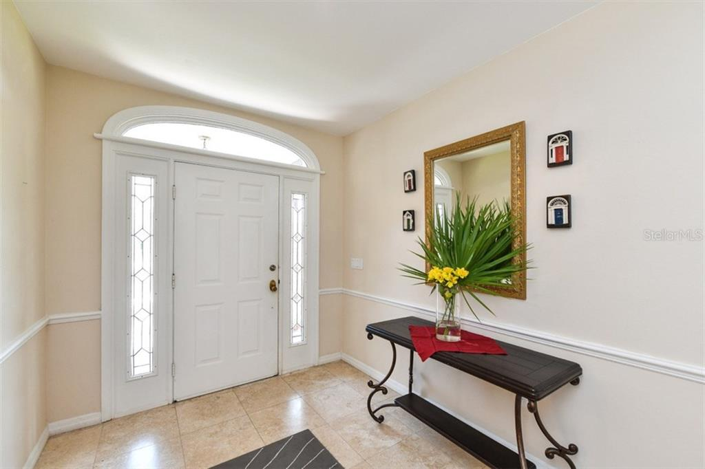 Foyer. Note lovely ceramic tile which is throughout home except for the office and bedrooms. - Single Family Home for sale at 7536 Weeping Willow Dr, Sarasota, FL 34241 - MLS Number is A4210209