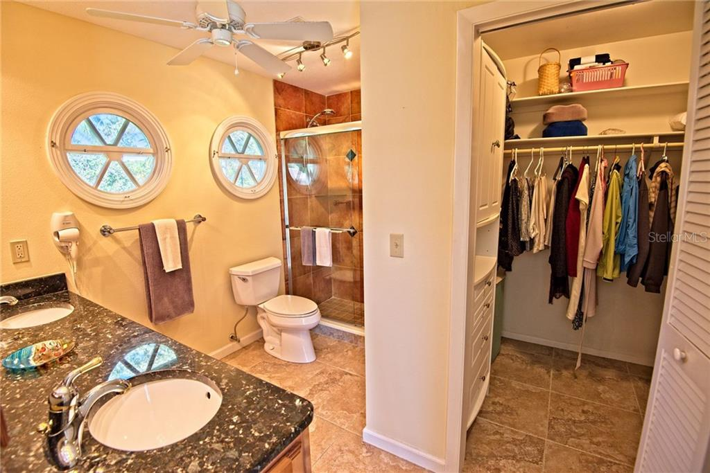 Master bathroom with walk-in custom built closet - Single Family Home for sale at 600 Wild Turkey Ln, Sarasota, FL 34236 - MLS Number is A4210585