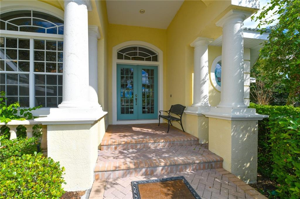 Freshly painted front doors, columns and exterior trim.  Handsome brick paver sidewalk and driveway. - Single Family Home for sale at 5585 Siesta Estates Ct, Sarasota, FL 34242 - MLS Number is A4211109