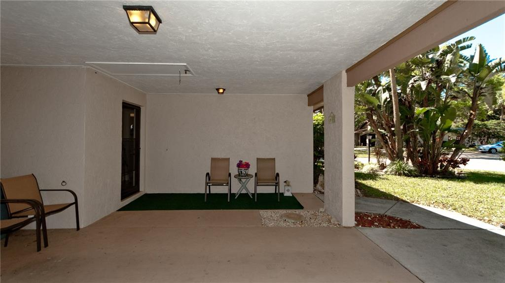 Covered front carport with entry space for parking 1 car. - Condo for sale at 5107 29th St W #n/A, Bradenton, FL 34207 - MLS Number is A4213034