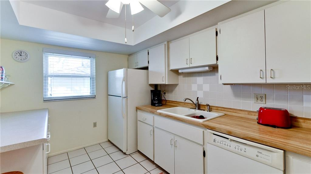 Kitchen has lots of cabinet storage and ceiling fan. - Condo for sale at 5107 29th St W #n/A, Bradenton, FL 34207 - MLS Number is A4213034