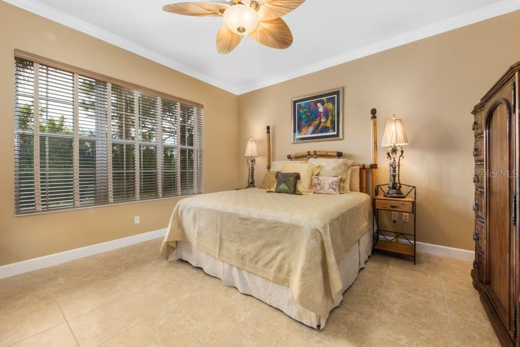 15' X 15' Master Bedroom with tinted insulated double pane windows for soundproofing and energy efficiency. The Master Bedroom has his and her separate closets. - Condo for sale at 7504 Botanica Pkwy #101, Sarasota, FL 34238 - MLS Number is A4213208