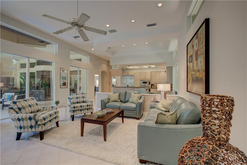 Tiled flooring, volume ceilings and plenty of natural sunlight! - Single Family Home for sale at 3896 Boca Pointe Dr, Sarasota, FL 34238 - MLS Number is A4213831