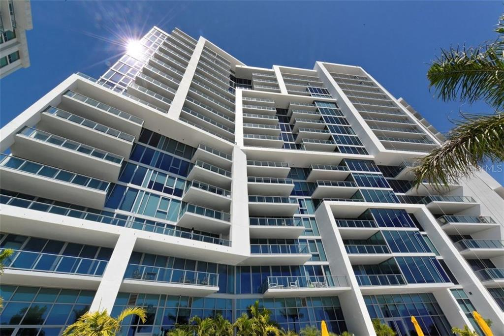 A view of the building from the pool deck - Condo for sale at 1155 N Gulfstream Ave #1504, Sarasota, FL 34236 - MLS Number is A4215032