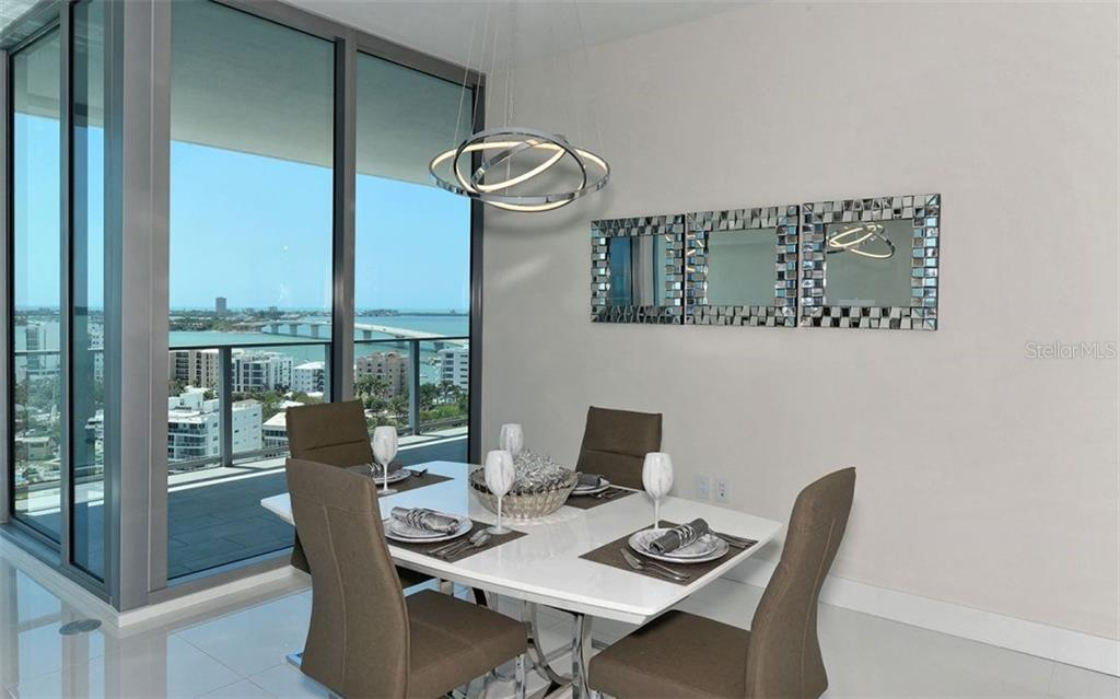 Dining area overlooking the waterfront - Condo for sale at 1155 N Gulfstream Ave #1504, Sarasota, FL 34236 - MLS Number is A4215032