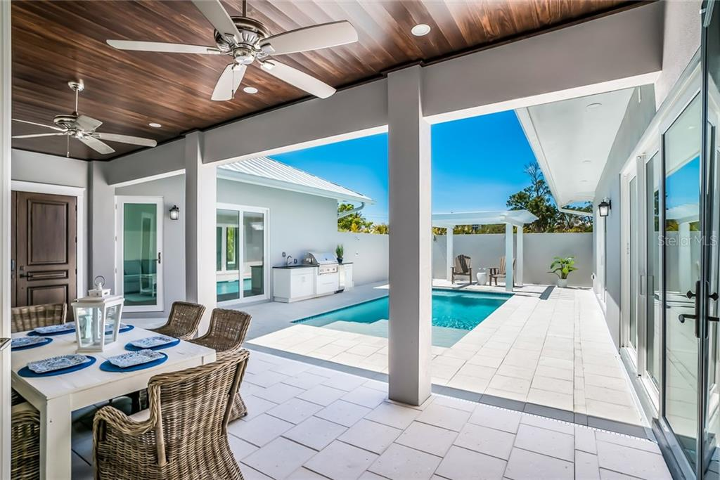 Courtyard Outdoor Living - Single Family Home for sale at 601 Triton Bnd, Longboat Key, FL 34228 - MLS Number is A4215179