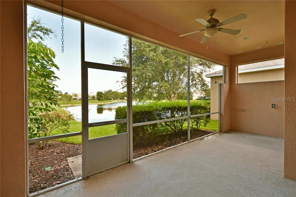 Screened lanai with surround sound speakers and pre-plumbed for an outdoor kitchen.  Enjoy your dessert with beautiful sunsets overlooking the lake. - Single Family Home for sale at 3729 Summerwind Cir, Bradenton, FL 34209 - MLS Number is A4215992