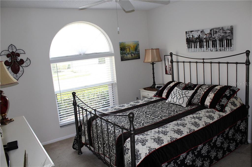 The 3rd bedroom also functions well as a den, with it's double door entry right off the front foyer.  And the arched window adds style and light. - Villa for sale at 5438 Kelly Dr #12, Sarasota, FL 34233 - MLS Number is A4400319