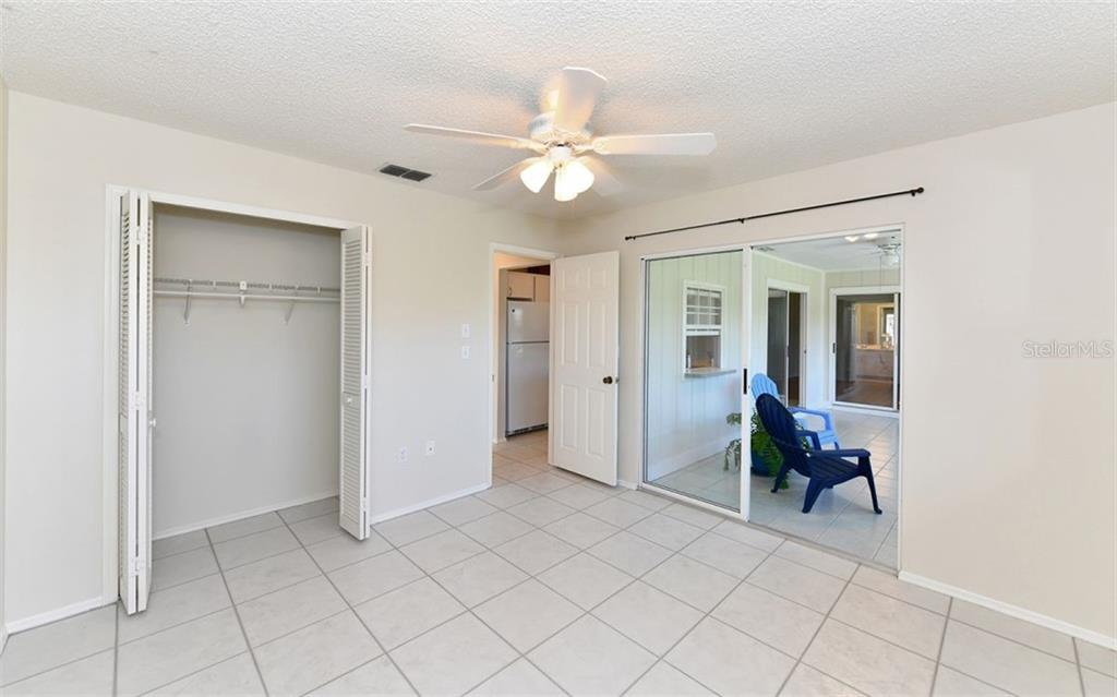 Bedroom Three has water views and also exits to the Enclosed Air Conditioned Sunroom... - Single Family Home for sale at 6202 65th Ct E, Palmetto, FL 34221 - MLS Number is A4400567