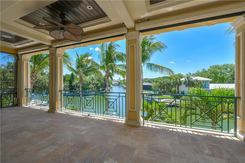 Upper Terrace with access from Master Bedroom, a guest room and the bonus room.  Electric Screens - Single Family Home for sale at 506 Venice Ln, Sarasota, FL 34242 - MLS Number is A4402493