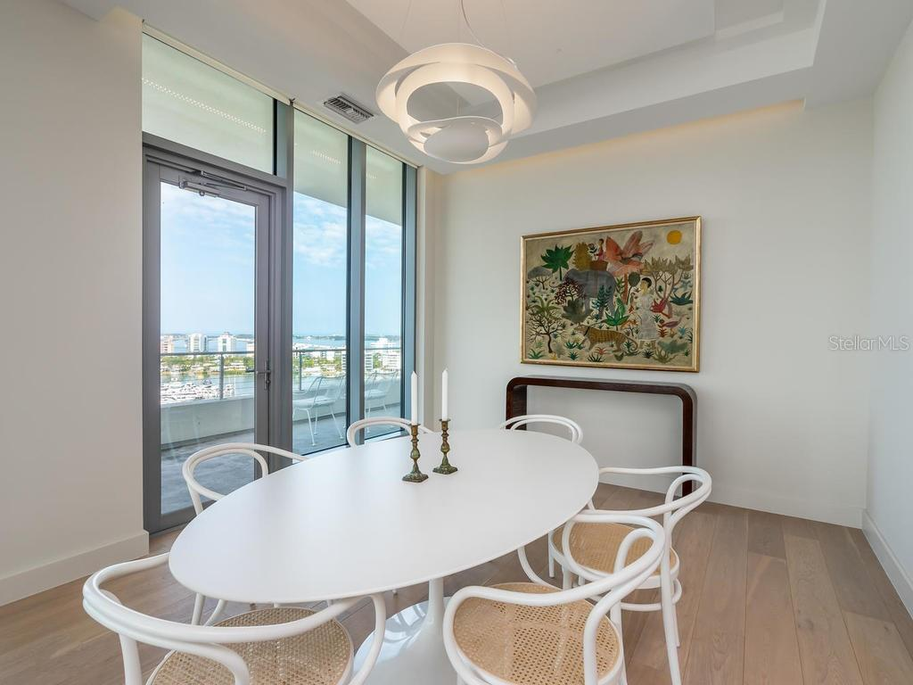 Dining space with expansive views of Sarasota Bay and Golden Gate. - Condo for sale at 1301 Main St #1001, Sarasota, FL 34236 - MLS Number is A4402790