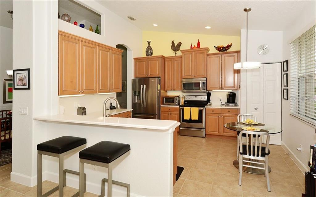 Kitchen area - Single Family Home for sale at 6507 42nd St E, Sarasota, FL 34243 - MLS Number is A4404611