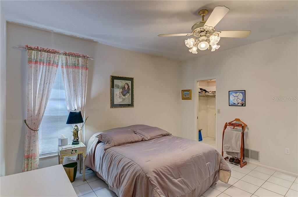Third Bedroom with walk-in closet - Single Family Home for sale at 3911 Spyglass Hill Rd, Sarasota, FL 34238 - MLS Number is A4404657