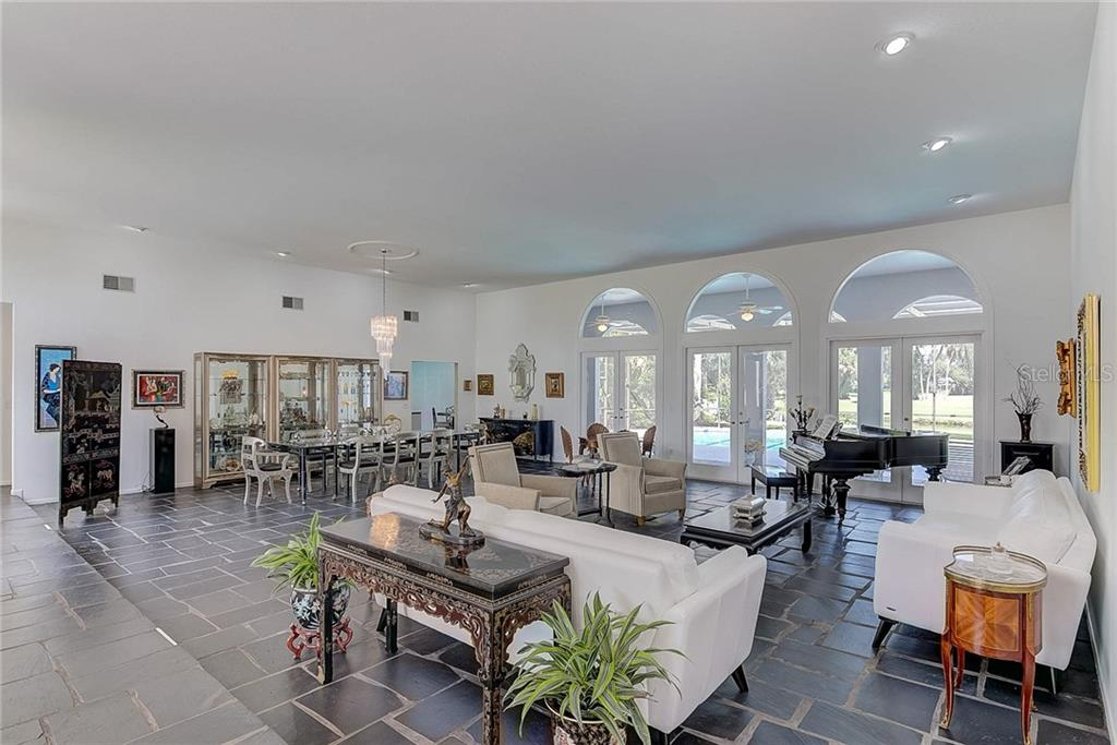 The Great Room combines formal dining & living room - Single Family Home for sale at 3911 Spyglass Hill Rd, Sarasota, FL 34238 - MLS Number is A4404657