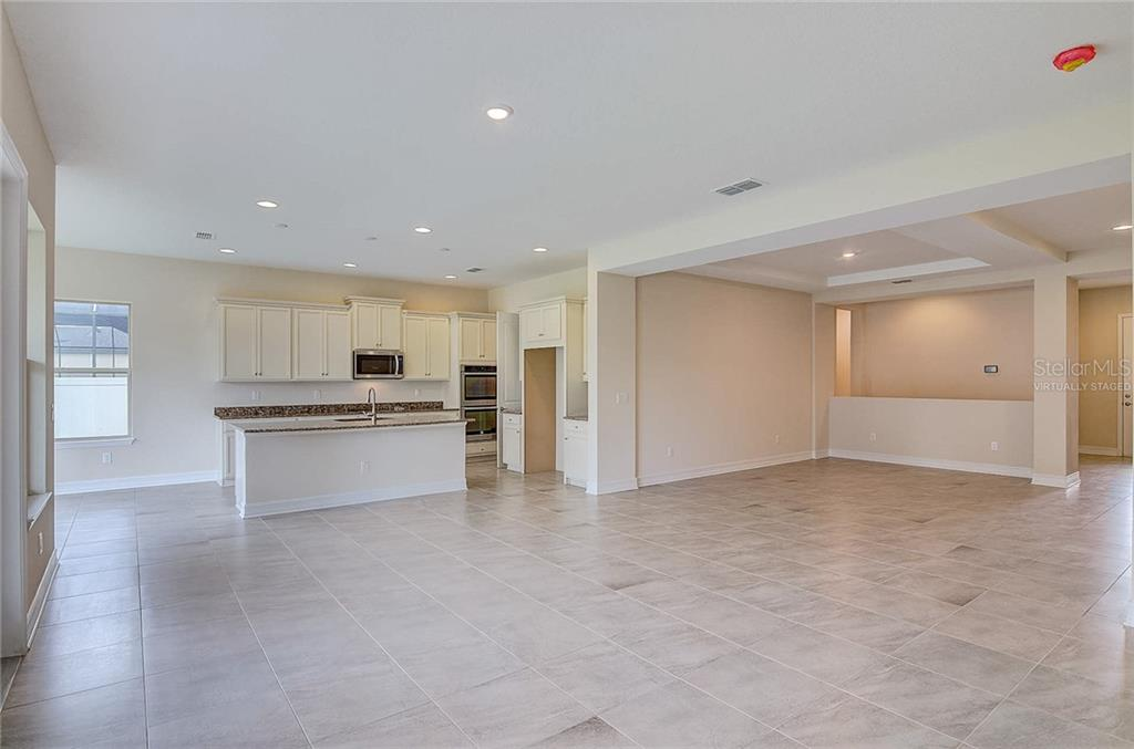 Natural light abounds throughout the open layout! - Single Family Home for sale at 13019 Utopia Loop, Bradenton, FL 34211 - MLS Number is A4404703