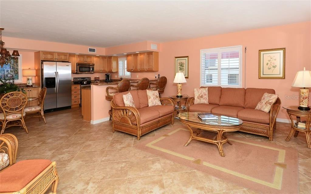 Open updated kitchen, Stainless steel appliances, Lunch counter. - Condo for sale at 4311 Gulf Of Mexico Dr #601, Longboat Key, FL 34228 - MLS Number is A4405195