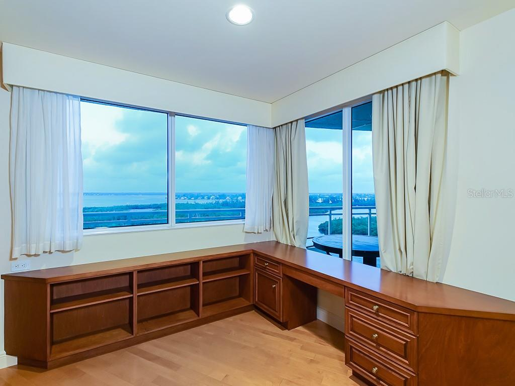 Living Room - Nature/Preserve and City Views - Condo for sale at 1300 Benjamin Franklin Dr #1008, Sarasota, FL 34236 - MLS Number is A4405360