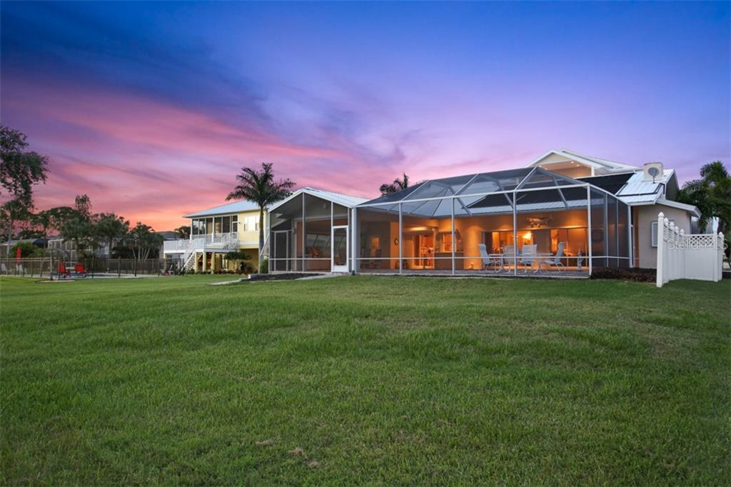 Gorgeous sunset over the home from the backyard - Single Family Home for sale at 1778 Bayshore Dr, Englewood, FL 34223 - MLS Number is A4405962