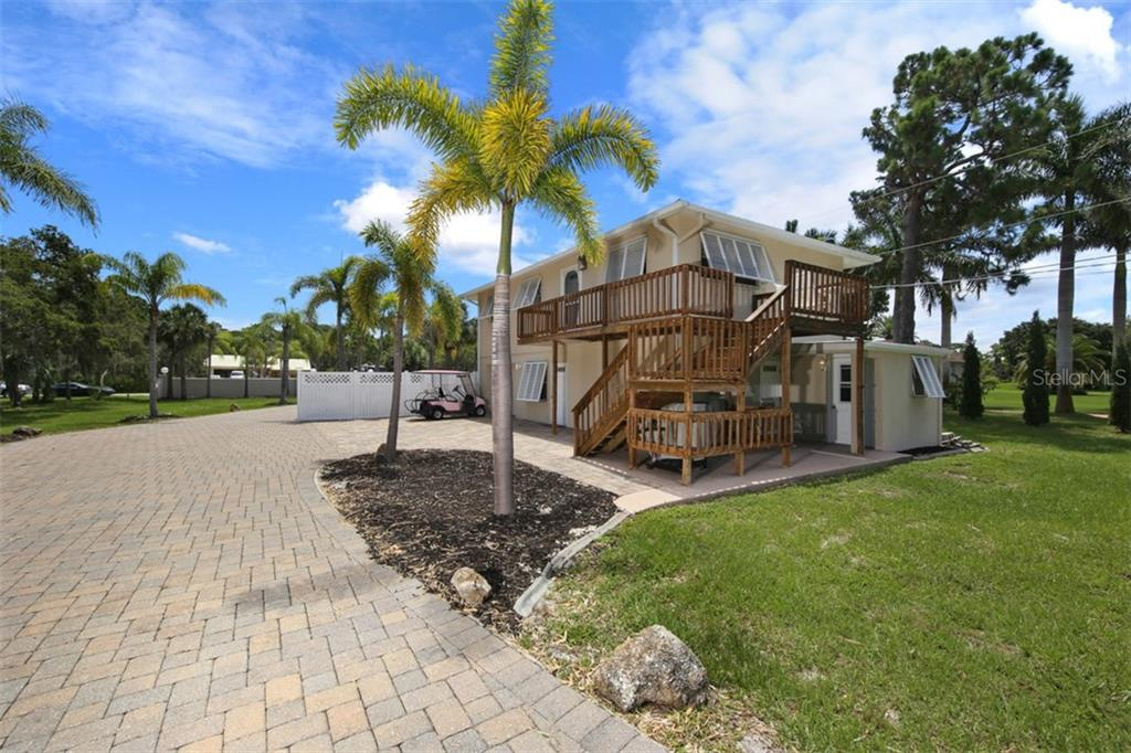 2 Unit Guest House, Seasonally rented at $4,200/Month+ - Single Family Home for sale at 1778 Bayshore Dr, Englewood, FL 34223 - MLS Number is A4405962