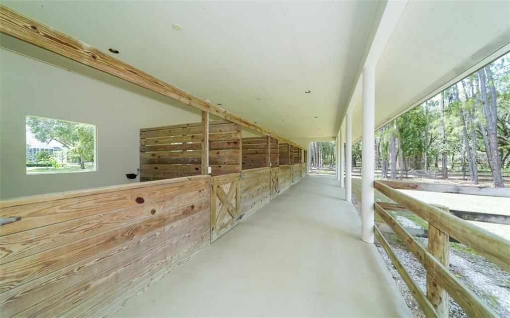 Six Beautiful 12x12 horse stables.  Complete with water and electricity, Easy access to the pastures and individual open windows in the back of each stable! - Single Family Home for sale at 7866 Saddle Creek Trl, Sarasota, FL 34241 - MLS Number is A4407172
