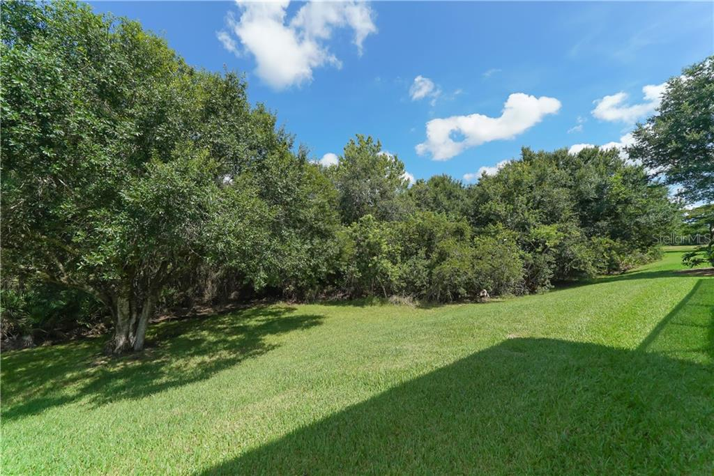 Large lawn space in backyard. - Single Family Home for sale at 13219 Palmers Creek Ter, Lakewood Ranch, FL 34202 - MLS Number is A4407857