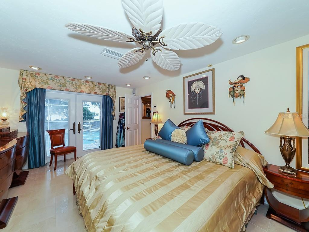Master Bedroom - French Doors to Pool and Lanai - Single Family Home for sale at 916 N Casey Key Rd, Osprey, FL 34229 - MLS Number is A4408082